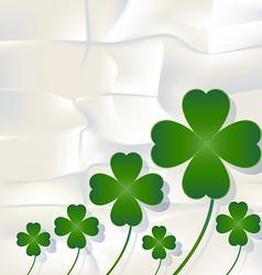 Cloverleaf and shamrock leaf on white paper vector image
