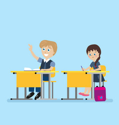 Schoolchild sits at a school desk during lessons vector