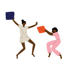 two girls in pajamas playing pillow fight at vector image