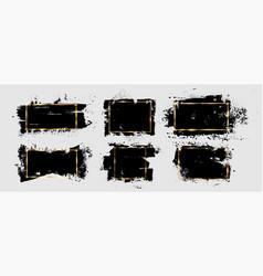 Grunge brushstroke and splatter with gold frame vector