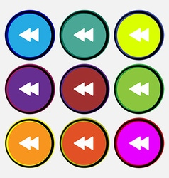 Rewind icon sign Nine multi-colored round buttons vector