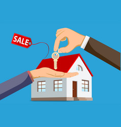 Realtor gives house keys to buyer vector