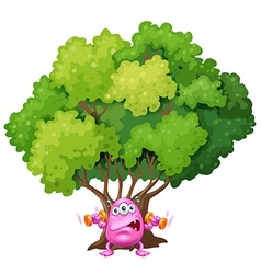 A pink monster exercising under the tree vector image