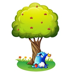 A poisoned blue monster under the tree vector image