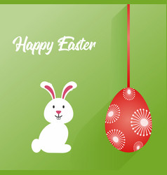 easter bunny and a decorative hanged egg over vector image