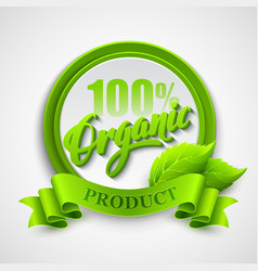 Organic emblem with ribbon and green leaves vector image vector image