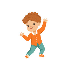 Cute redhead little boy dancing in casual clothes vector