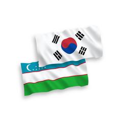 Flags south korea and uzbekistan on a white vector