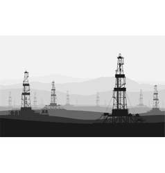 Oil rigs at large oilfield over mountain range vector image