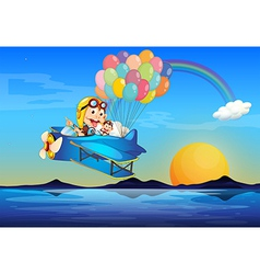 A plane with monkeys and balloons vector