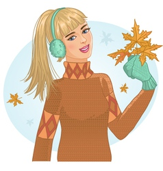 Young woman with autumn maple leaves in hand vector image