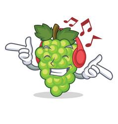 Listening music green grapes mascot cartoon vector