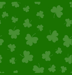 Seamless green shamrock clover leaf pattern vector