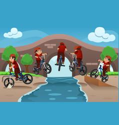 Kids doing bike tricks vector