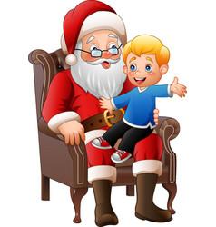 Santa claus sitting with a little cute boy vector