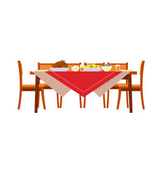 Served holiday table with food and chairs vector