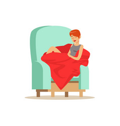 Beautiful young woman wrapped in red blanket vector