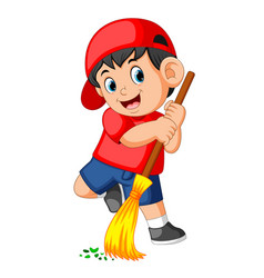 Happy boy using the red cap sweep the trash vector