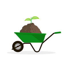 Wheelbarrow with pile of soil and green sprout vector