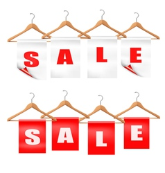 Wooden hangers with sale tags Discount concept vector image vector image