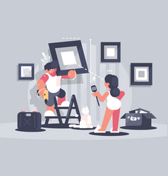 guy hangs picture on wall vector image vector image