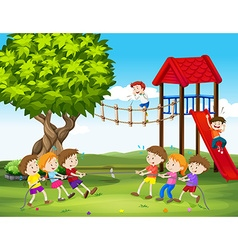 Children playing tug of war in the playground vector image vector image