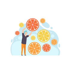 Young man with slices of lemon grapefruit and vector