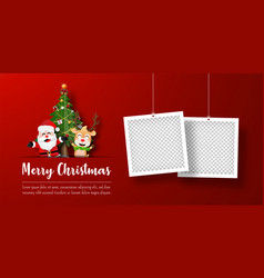 santa claus and reindeer with photo frame vector image
