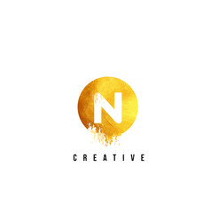 N gold letter logo design with round circular vector