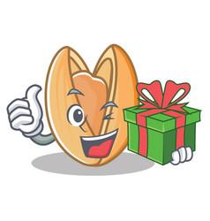 With gift pistachio nut mascot cartoon vector