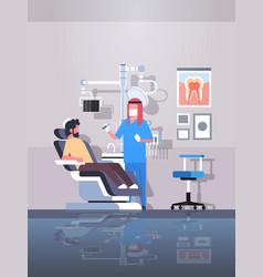 male arab dentist drilling teeth of man patient vector image