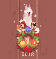 New year 2018 card with cute dogs over fir garland vector