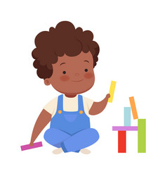 Boy is building from colorful blocks vector