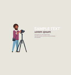 man professional photographer taking photo african vector image