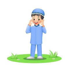 Cute muslim boy standing on grass vector