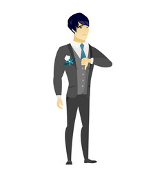 Disappointed asian groom with thumb down vector