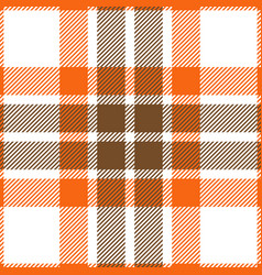 Orange and brown tartan plaid seamless pattern vector