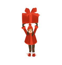 smiling teen girl holding huge christmas present vector image