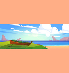 sea beach with old boat in green grass vector image