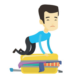 Young man trying to close suitcase vector