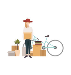 Young girl moving into a new house with things vector