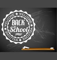 Back to school white on a chalkboard vector