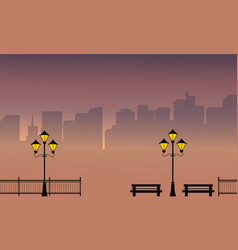 Silhouette of town at night with street lamp vector