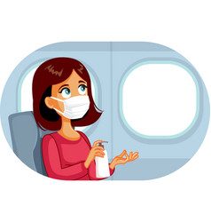 Woman wearing face mask using hand sanitizer vector