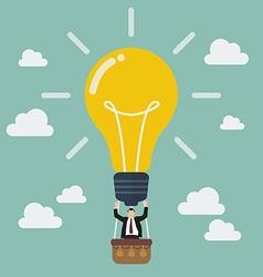Businessman celebrating in lightbulb balloon vector image