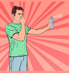 Pop art man spraying can of air freshener vector