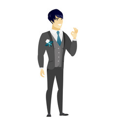 Smiling groom showing ok sign vector