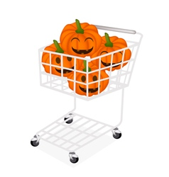 Jack-o-lantern pumpkins in a shopping cart vector
