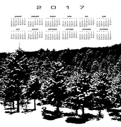 A 2017 calendar with a snow covered pine forest vector