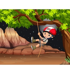 Boy climbing the tree at night vector image